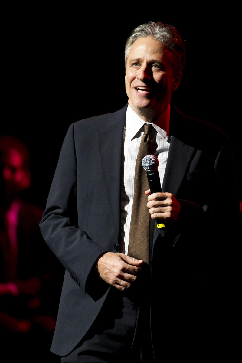 """FILE - In this Nov. 8, 2012, file photo, Jon Stewart performs at the 6th Annual Stand Up For Heroes benefit concert in New York. Stewart returned Tuesday, Sept. 3, 2013, to """"The Daily Show"""" after being off Comedy Central since June 6 directing and producing a movie. (Photo by Charles Sykes/Invision/AP, File)"""