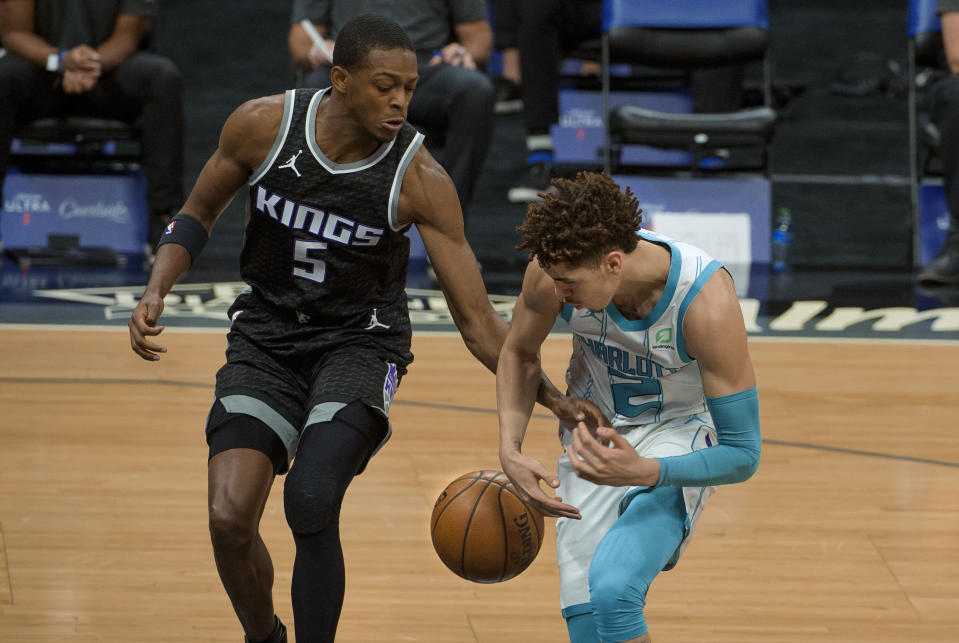 Sacramento Kings guard De'Aaron Fox (5) strips the ball from Charlotte Hornets guard LaMelo Ball (2) during the first quarter of an NBA basketball game in Sacramento, Calif., Sunday, Feb. 28, 2021. (AP Photo/Randall Benton)