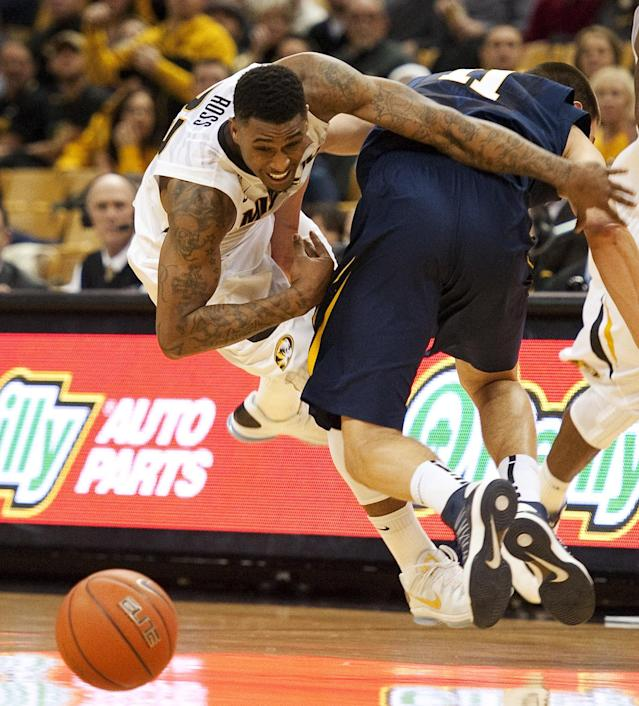 West Virginia's Nathan Adrian, right, collides with Missouri's Earnest Ross, left, as Ross brings the ball up court during the first half of an NCAA college basketball game Thursday, Dec. 5, 2013, in Columbia, Mo. (AP Photo/L.G. Patterson)