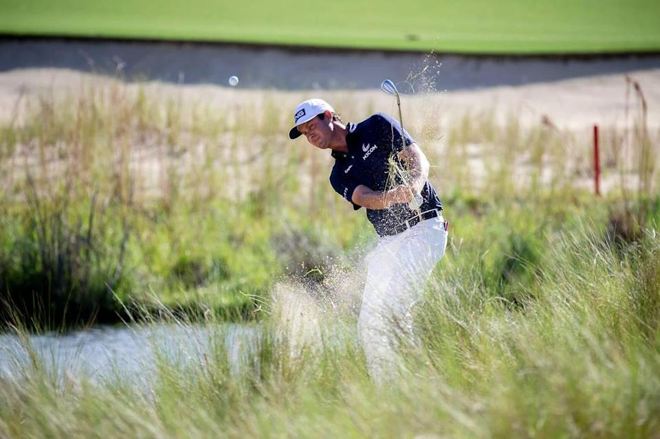 Harris English hits out of the bunker on the 18th green during the final round of the Palmetto Championship golf tournament in Ridgeland, S.C., Sunday, June 13, 2021. (AP Photo/Stephen B. Morton)