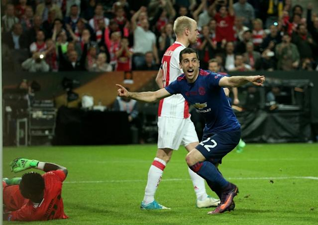 Manchester United's Henrikh Mkhitaryan (R) celebrates scoring against Ajax Amsterdam (L) during their UEFA Europa League final on May 24, 2017 at the Friends Arena in Solna outside Stockholm (AFP Photo/Soren Andersson)