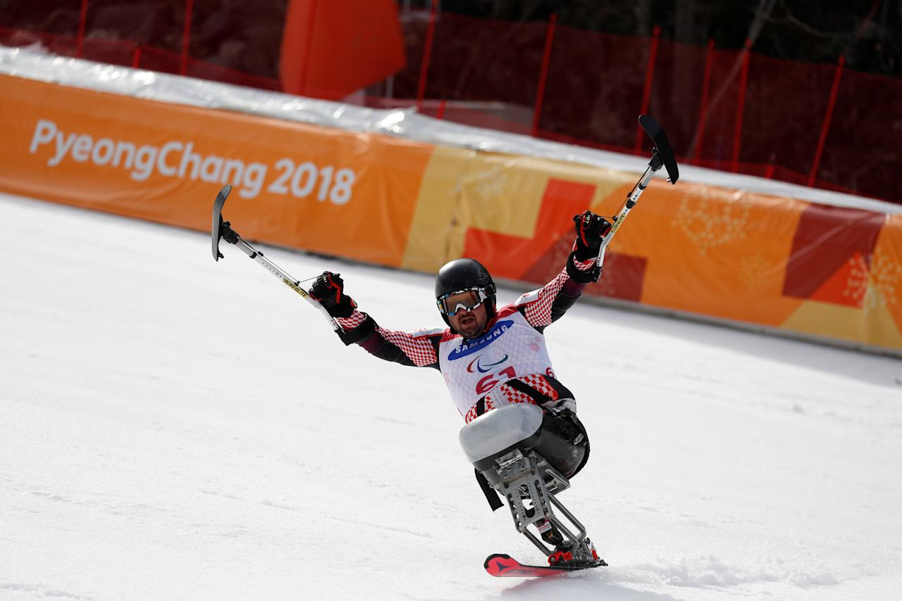 Alpine Skiing - Pyeongchang 2018 Winter Paralympics - Men's Slalom - Sitting - Final - Jeongseon Alpine Centre - Jeongseon, South Korea - March 17, 2018 - Dino Sokolovic of Croatia celebrates in the finish area after completing his run. REUTERS/Paul Hanna