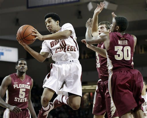 Boston College's Jordan Daniels (10) drives to the basket past Florida State's Luke Loucks (3), Ian Miller (30) and Bernard James (5) during the second half of an NCAA college basketball game in Boston on Wednesday, Feb. 8, 2012. Daniels led all scorers with 19 points in Boston College's 64-60 victory. (AP Photo/Elise Amendola)