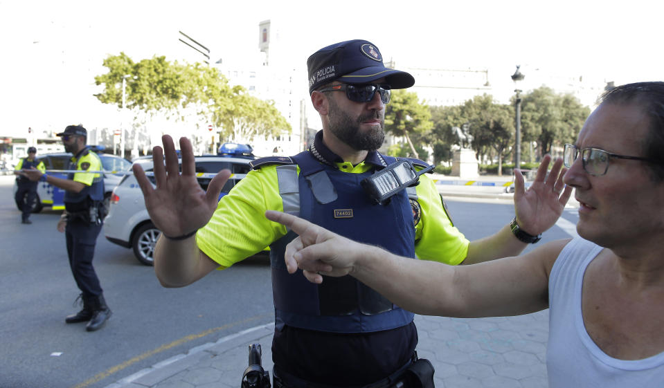 <p>Police officers tell members of the public to leave the scene in a street in Barcelona, Spain, Thursday, Aug. 17, 2017. (AP Photo/Manu Fernandez) </p>