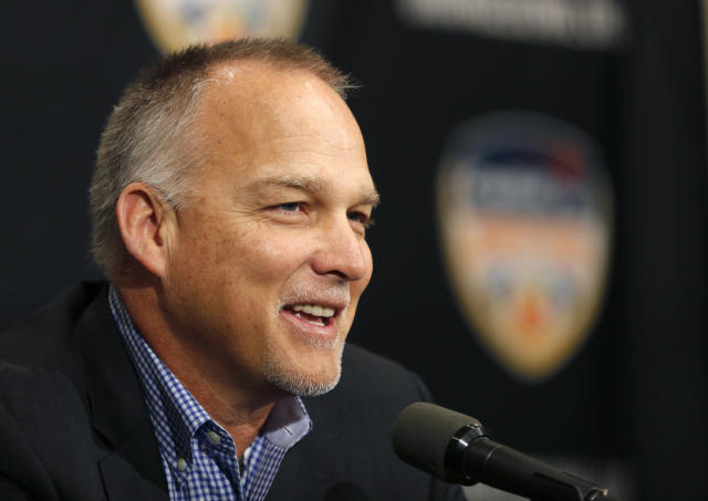 "FILE - In this Dec. 29, 2017, file photo, Miami head coach Mark Richt speaks at an NCAA college football news conference in Fort Lauderdale, Fla. Richt is being rewarded for getting Miami football back on track. The Hurricanes extended Richt's deal through 2023, putting him under contract for six years again. ""Mark has done a phenomenal job of building this program and generating enthusiasm for this program since the day he arrived back on campus,"" Miami athletic director Blake James said Thursday, May 3, 2018. (AP Photo/Joe Skipper, File)"