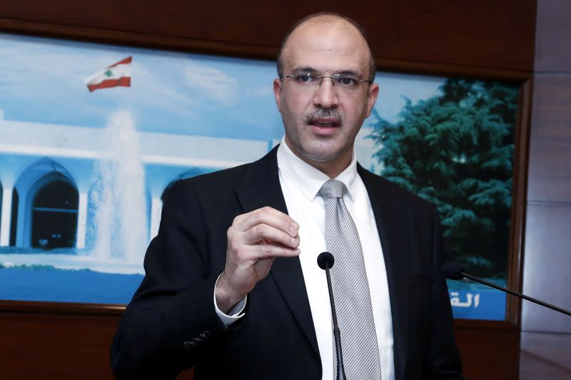 Lebanon's caretaker health minister Hamad Hasan, gestures as he speaks at the presidential palace in Baabda