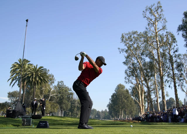 Tiger Woods tees off on the 12th hole during the final round of the Genesis Invitational golf tournament at Riviera Country Club, Sunday, Feb. 16, 2020, in the Pacific Palisades area of Los Angeles. (AP Photo/Ryan Kang)