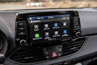 <p>On the inside, heated black leather seats with red stitching and piping are standard, as are a new shift knob, a new leather-wrapped steering wheel, a different gauge cluster, and, of course, more N Line badging. </p>