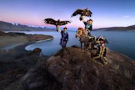 <p>Daniel witnessed the eagle hunters showing their skills via traditional games such as calling from the cliff. (Photo: Daniel Kordan/Caters News) </p>