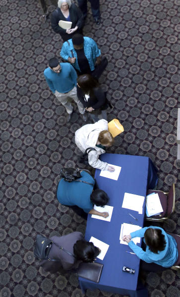 In this Wednesday, Jan. 22, 2014, photo, job seekers line up to meet prospective employers during a career fair at a hotel in Dallas. The government issues the January jobs report on Friday, Feb. 7. 2014. (AP Photo/LM Otero)