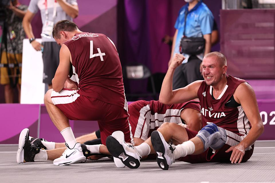 <p>TOKYO, JAPAN - JULY 28: Edgars Krumins of Team Latvia celebrates victory and winning the gold medal in the 3x3 Basketball competition on day five of the Tokyo 2020 Olympic Games at Aomi Urban Sports Park on July 28, 2021 in Tokyo, Japan. (Photo by Christian Petersen/Getty Images)</p>