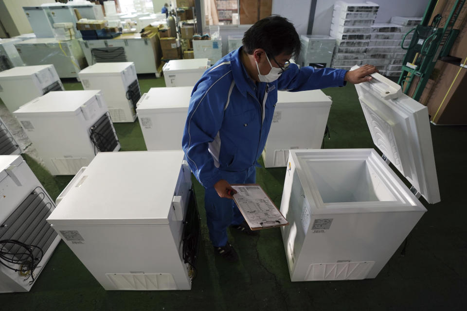 Brand-new ultralow-temperature freezers are seen at warehouse at Kanou Reiki, a freezer supplier, Friday, Jan. 22, 2021 in Sagamihara, west of Tokyo. Some of COVID-19 vaccine must be kept at the ultra-cold temperature of around -70 degrees Celsius (-94 Fahrenheit). Japan is accelerating preparations for COVID-19 vaccinations in hopes of starting them in late February, but uncertainty is growing as the country faces vaccine-shy public, slow approval process and bureaucratic roadblocks, casting a doubt if Tokyo Olympic this summer is possible. (AP Photo/Eugene Hoshiko)