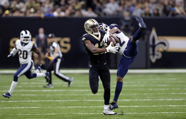 FILE - In this Nov. 4, 2018, file photo, New Orleans Saints wide receiver Michael Thomas (13) pulls in a pass against Los Angeles Rams cornerback Marcus Peters (22) during the first half of an NFL football game in New Orleans. Peters criticized himself for playing poorly when the Rams took their first loss of the season at New Orleans last weekend. That doesn't mean Saints coach Sean Payton can say anything about it, however. Peters reacted sharply in the Rams' locker room Thursday, Nov. 8, when asked about postgame comments by Payton in which the veteran coach said the Saints liked the matchup of receiver Michael Thomas going against Peters, a former Pro Bowl selection. (AP Photo/Bill Feig, File)