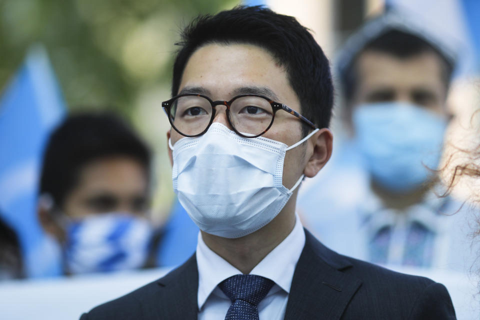 Hong Kong activist Nathan Law takes part in a protest during the visit of Chinese Foreign Minister Wang Yi in Berlin, Germany, Tuesday, Sept. 1, 2020. German Foreign Minister Heiko Maas meets his Chinese counterpart at the foreign ministry guest house Villa Borsig for bilateral talks. (AP Photo/Markus Schreiber)