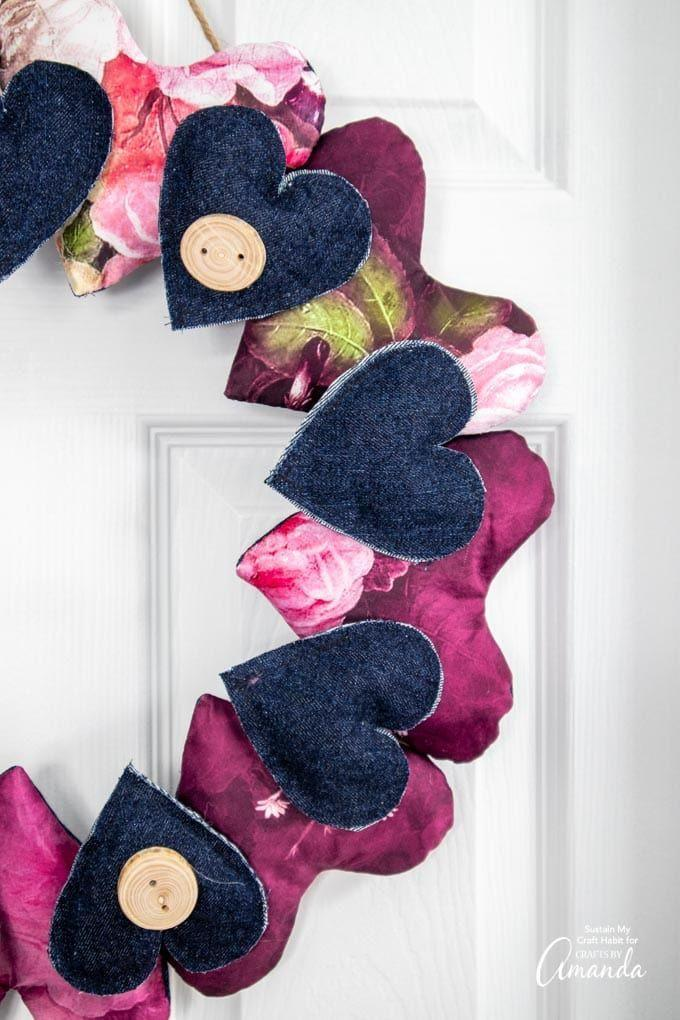 """<p>For a non-traditional Valentine's door hanger, consider using a round wreath hoop and denim and patterned fabric. You can even utilize old scrap material that's been sitting around your craft room to keep costs down.</p><p><strong>Get the tutorial at <a href=""""https://craftsbyamanda.com/heart-wreath/"""" rel=""""nofollow noopener"""" target=""""_blank"""" data-ylk=""""slk:Crafts by Amanda"""" class=""""link rapid-noclick-resp"""">Crafts by Amanda</a>.</strong></p><p><strong><a class=""""link rapid-noclick-resp"""" href=""""https://www.amazon.com/Fabric-Sewing-Crafting-Indigo-Flavor/dp/B07XP6C9L9/ref=as_li_ss_tl?tag=syn-yahoo-20&ascsubtag=%5Bartid%7C10050.g.35057743%5Bsrc%7Cyahoo-us"""" rel=""""nofollow noopener"""" target=""""_blank"""" data-ylk=""""slk:SHOP DENIM FABRIC"""">SHOP DENIM FABRIC</a><br></strong></p>"""