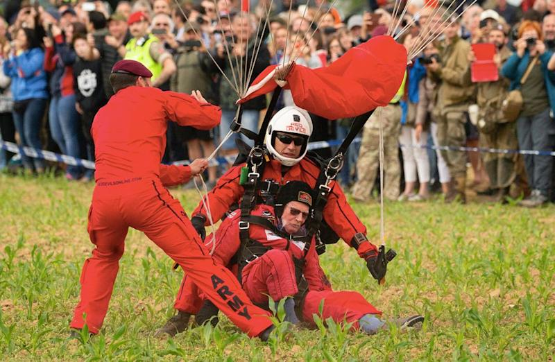 Mr Read completing his tandem parachute jump with the Red Devils (PA)