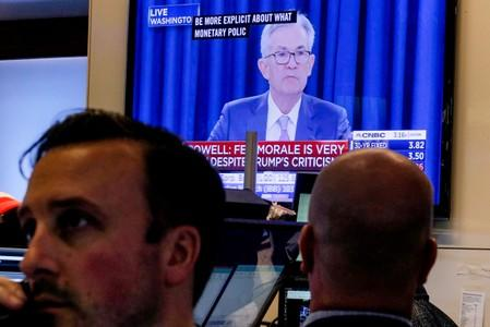 Traders work as a screen shows Federal Reserve Chairman Jerome Powell's news conference after the U.S. Federal Reserve interest rates announcement on the floor of the  NYSE in New York