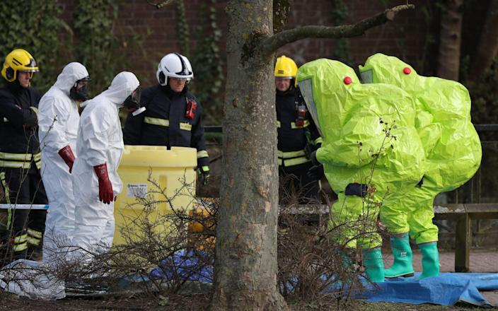 Photo dated 08/03/18 of personnel in hazmat suits waiting for decontamination after securing a tent covering a bench in the Maltings shopping centre in Salisbury, where former Russian double agent Sergei Skripal and his daughter Yulia were found critically ill due to exposure to the nerve agent Novichok - PA