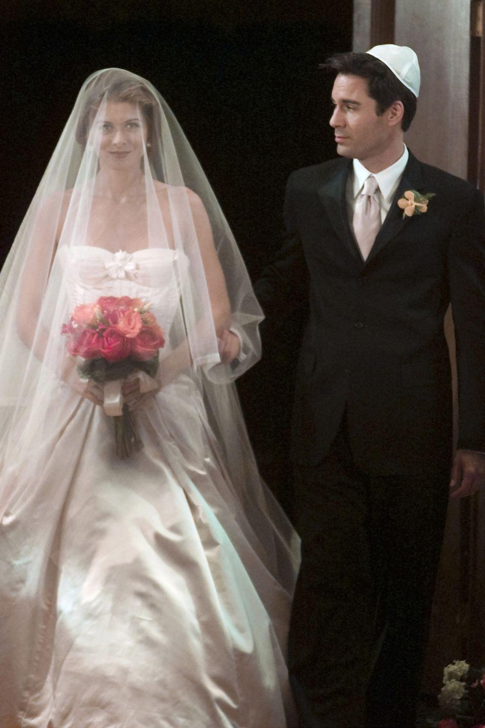 <p>Grace walked down the aisle in season 5 to marry her boyfriend of two months, Leo, wearing a strapless gown with an elegant veil. And, in a very fitting gesture, her BFF Will walked her down the aisle. </p>