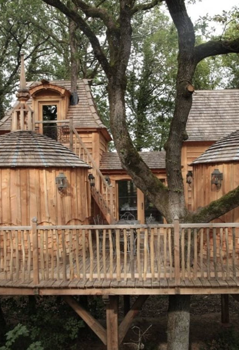 """<p>Inspired by the castle of Dordogne nearby, this elegant treehouse in France certainly seems fit for royalty. It boasts a moat and wooden footbridge that leads to a spacious interior courtyard.</p><p><a class=""""link rapid-noclick-resp"""" href=""""https://go.redirectingat.com?id=74968X1596630&url=https%3A%2F%2Fwww.tripadvisor.com%2FHotel_Review-g187082-d3583324-Reviews-Chateaux_Dans_les_Arbres-Bergerac_City_Bergerac_Dordogne_Nouvelle_Aquitaine.html&sref=https%3A%2F%2Fwww.housebeautiful.com%2Fdesign-inspiration%2Fhouse-tours%2Fg3301%2Famazing-tree-house-homes%2F"""" rel=""""nofollow noopener"""" target=""""_blank"""" data-ylk=""""slk:BOOK NOW"""">BOOK NOW</a> <strong><em>Châteaux Dans Les Arbres</em></strong><br></p>"""