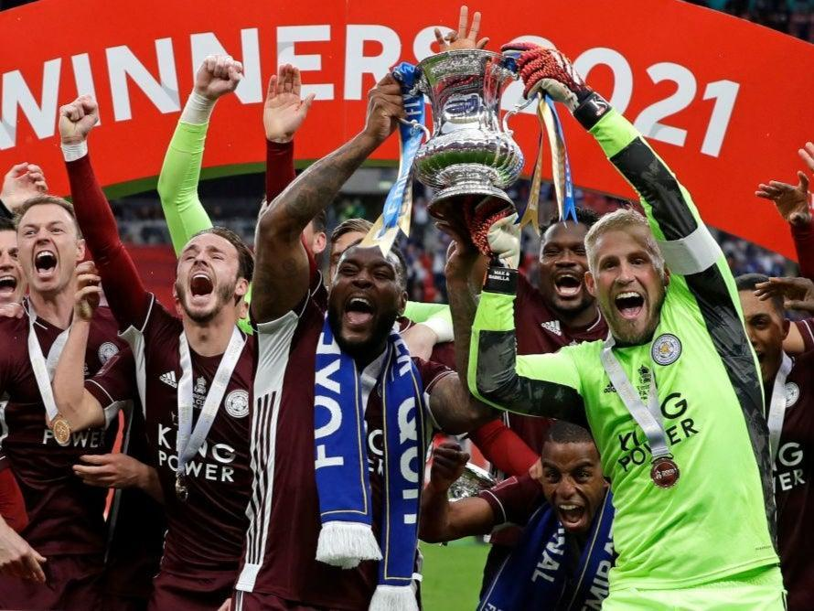 <p>Leicester lift the trophy at Wembley</p> (POOL/AFP via Getty Images)