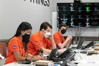 Engineers in orange shirts were glued to their screens at the Jet Propulsion Laboratory in California, where the mission had been planned for the past six years