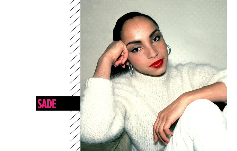 <p>Singer Sade's slicked-back ponytail braid and scarlet lipstick is a winning combination that became her signature look. (Photo: Getty Images) </p>