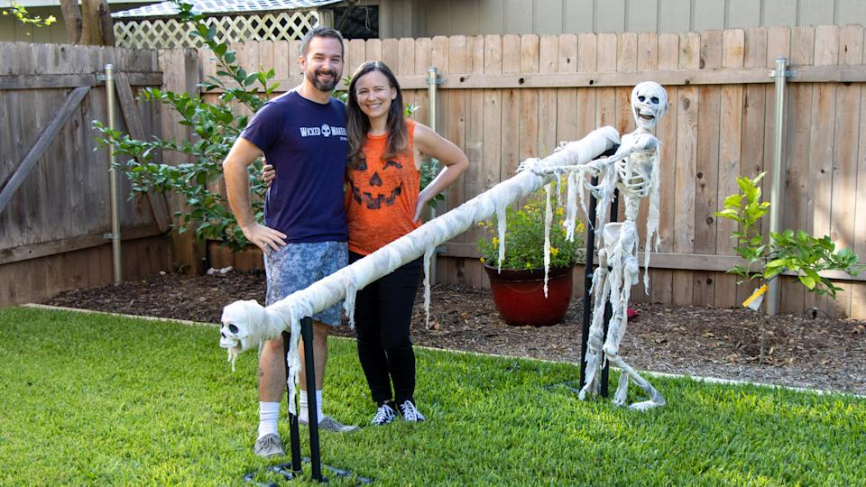 Jay and Jaimie stand near the candy slide they created for Halloween amid the pandemic. (Photo: Jay & Jaimie)