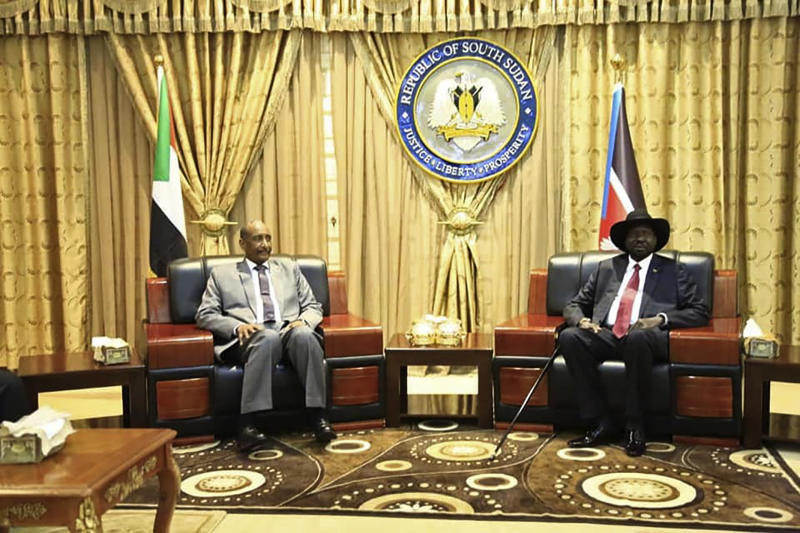 In this photo provided by the official SUNA news agency, Gen. Abdel-Fattah Burhan, left, head of Sudan's sovereign council, meets with South Sudan's President Salva Kiir, in Juba, South Sudan, Monday, Oct. 14, 2019. Sudan's new transitional government is starting talks Monday with rebel leaders in South Sudan's capital, Juba to kick off peace talks aimed at ending the country's yearslong civil wars. Achieving peace is crucial to the transitional government in Sudan. It has counted on ending the wars with rebels in order to revive the country's battered economy through slashing the military spending, which takes up much of the national budget. (SUNA via AP)