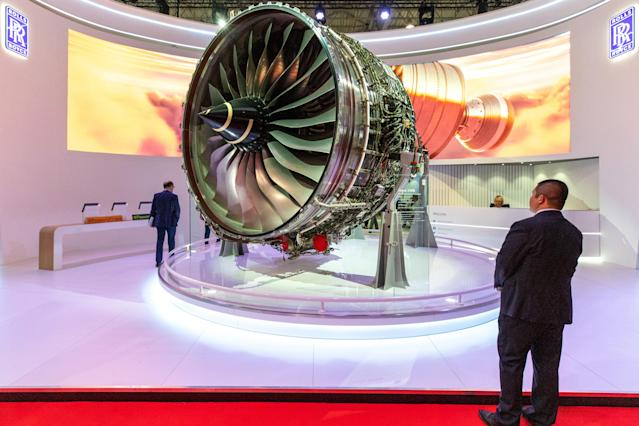 An attendee looks at a Rolls-Royce Holdings Plc Trent XWB aircraft engine on display at the Rolls Royce pavilion. (Christopher Pike/Bloomberg)