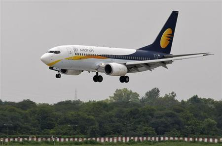 A Jet Airways passenger aircraft prepares to land at the airport in the western Indian city of Ahmedabad August 12, 2013.