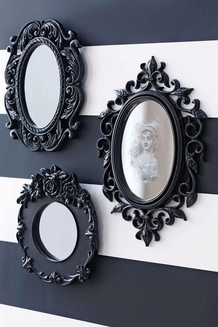 """<p>Everyone will do a double-take when they see this spooky mirror hanging on your wall. </p><p><strong><em><a href=""""https://www.womansday.com/home/crafts-projects/how-to/a5859/craft-project-spooky-halloween-mirror-123590/"""" rel=""""nofollow noopener"""" target=""""_blank"""" data-ylk=""""slk:Get the Spooky Mirror tutorial"""" class=""""link rapid-noclick-resp"""">Get the Spooky Mirror tutorial</a>. </em></strong></p><p><a class=""""link rapid-noclick-resp"""" href=""""https://www.amazon.com/Rust-Oleum-271903-Automotive-Spray-Paint/dp/B07GL3CDCB?tag=syn-yahoo-20&ascsubtag=%5Bartid%7C10070.g.2488%5Bsrc%7Cyahoo-us"""" rel=""""nofollow noopener"""" target=""""_blank"""" data-ylk=""""slk:SHOP BLACK SPRAY PAINT"""">SHOP BLACK SPRAY PAINT</a></p>"""