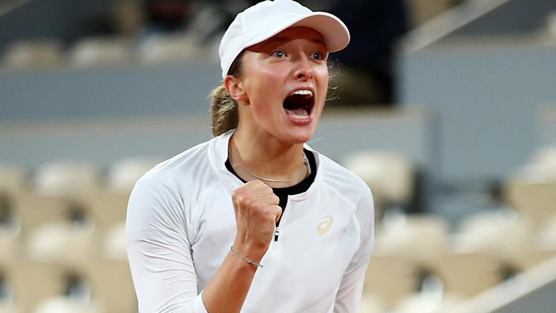 Iga Swiatek is pictured celebrating after defeating Simona Halep at the French Open 2020.