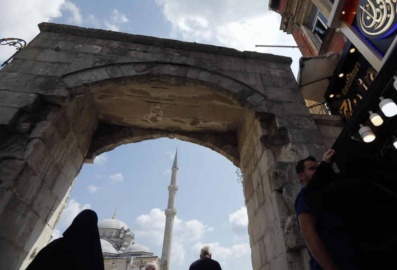 In this photo taken on Tuesday, Aug. 20, 2019, a man walks past Fatih mosque in Istanbul. Syrians say Turkey has been detaining and forcing some Syrian refugees to return back to their country the past month. The expulsions reflect increasing anti-refugee sentiment in Turkey, which opened its doors to millions of Syrians fleeing their country's civil war. (AP Photo/Lefteris Pitarakis)