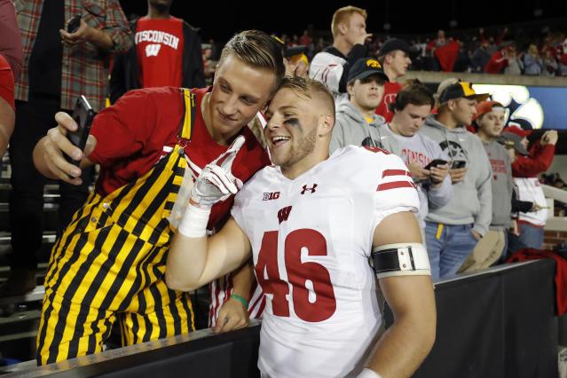 Wisconsin tight end Gabe Lloyd, right, poses for a photo with a fan after the team's 28-17 win over Iowa in an NCAA college football game Saturday, Sept. 22, 2018, in Iowa City. (AP Photo/Matthew Putney)