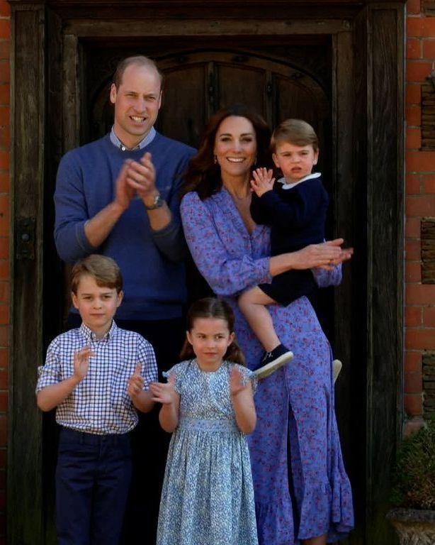 """<p>Kate <a href=""""https://www.townandcountrymag.com/society/tradition/a32256560/kate-middleton-blue-shirtdress-ghost-london-clap-for-carers-photos/"""" rel=""""nofollow noopener"""" target=""""_blank"""" data-ylk=""""slk:wore a cornflower blue floral midi dress"""" class=""""link rapid-noclick-resp"""">wore a cornflower blue floral midi dress</a> outside her country home as she and Prince William, George, Charlotte, and Louis clapped for NHS carers. The family appeared as part of the BBC Children In Need and Comic Relief """"Big Night In,"""" a program which is raising money for COVID-19 first responders. </p>"""