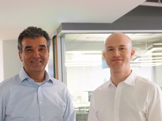 Coinbase's newly appointed president Asiff Hirji stands with co-founder and CEO Brian Armstrong.