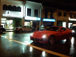 Expensive cars on a Singapore road