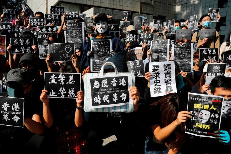 Graduates attend a ceremony to pay tribute to Chow Tsz-lok, 22, an university student who fell during protests at the weekend and died early on Friday morning, at the Hong Kong University of Science and Technology, in Hong Kong
