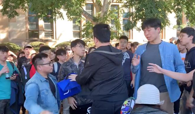 Hong Kong and mainland Chinese students clash during a pro-democracy protest at the university of Queensland in Australia. Photo: Twitter