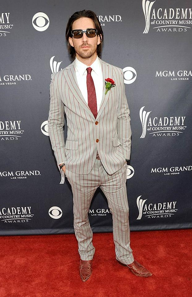 """Jake Owen  Grade: B+   While everyone might not agree, Jake Owen scored extra points with us for daring to be different in a dapper burgundy-and-gray pin-striped suit, which he accessorized with cowboy boots and boutonniere. Frazer Harrison/ACMA2011/<a href=""""http://www.gettyimages.com/"""" target=""""new"""">GettyImages.com</a> - April 3, 2011"""
