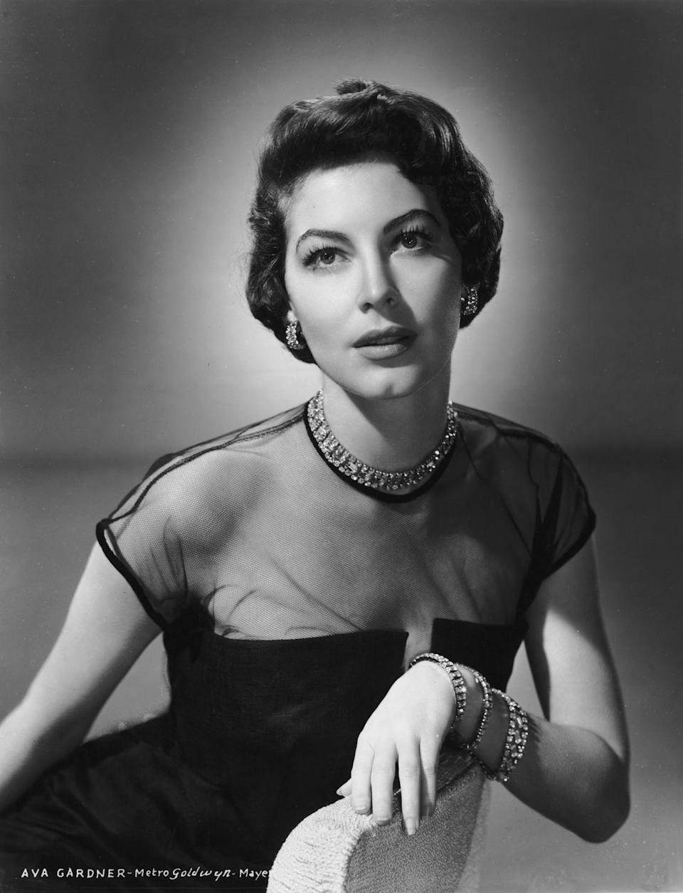 <p>Here, a studio portrait of the American actress showcases her timeless appeal and style. Women of today, take note: A diamond jewelry suite, a netted bodice, and a little black dress are always en vogue. <br></p>