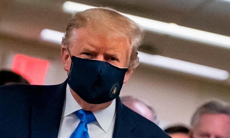 Trump wears a mask on a visit to Walter Reed National Military Medical Center in Maryland earlier this month.