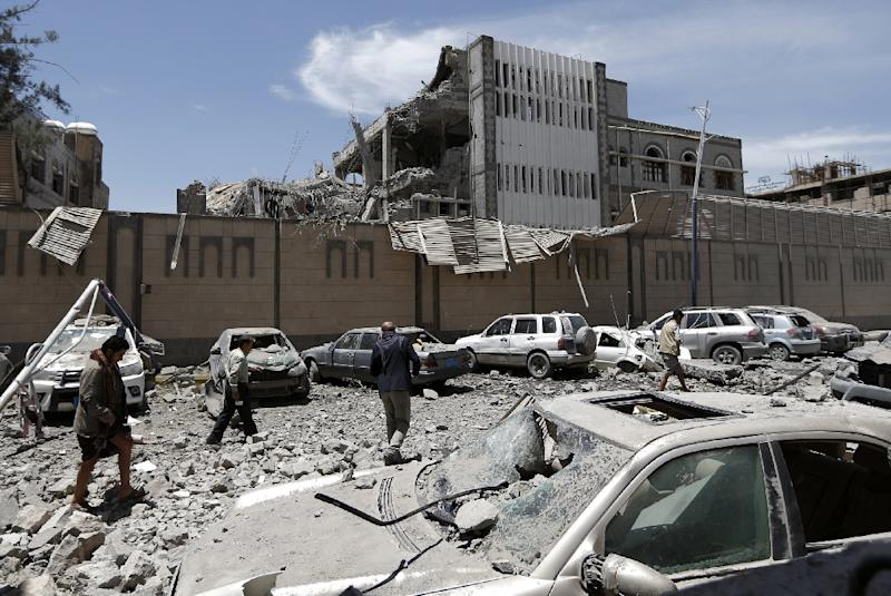 Yemenis check the presidential office building in the rebel-held capital Sanaa on May 7, 2018 after it was hit by air strikes that reportedly killed six people and wounded 30
