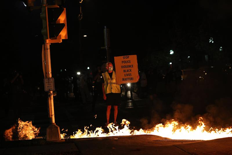 KENOSHA, WISCONSIN, USA - AUGUST 24: Jacob Blake protesters lit cleaning truck on fire in Kenosha, Wisconsin, United States on August 24, 2020. A police shooting in the US state of Wisconsin sent a Black man into serious condition on Sunday, with the video footage of the incident triggering outrage. (Photo by Tayfun Coskun/Anadolu Agency via Getty Images)