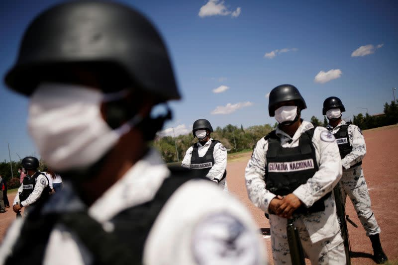 Members of Mexico's National Guard stand in formation as they hold a minute of silence as part of a 30-day national mourning for the deaths and infections caused by the coronavirus disease (COVID-19), in Ciudad Juarez