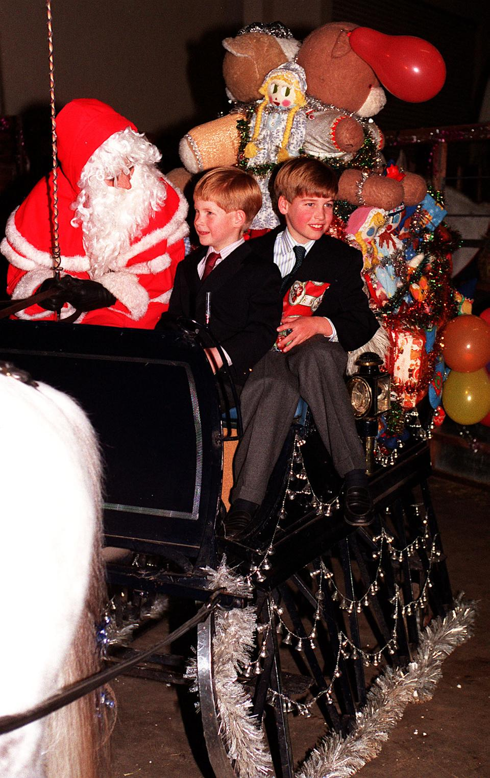 <p>William and Harry meeting Father Christmas during an exhibition at Olympia London in 1990. His mother wanted him to experience some normality in his life. (PA Photos)</p>