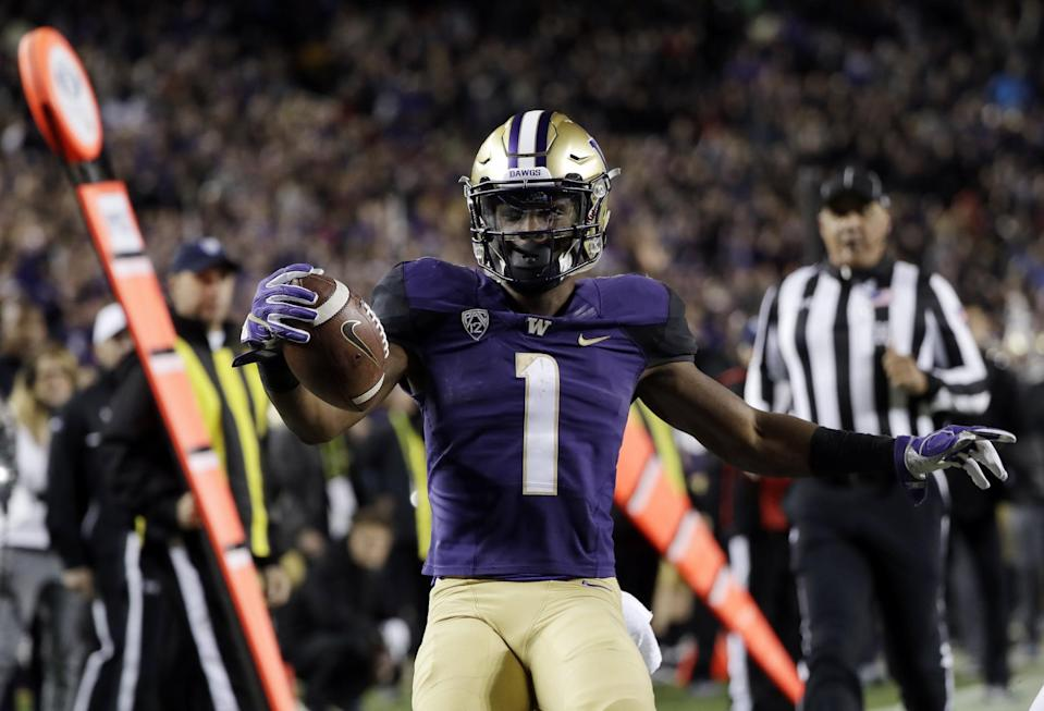 Washington WR John Ross has the kind of speed that NFL teams can build offenses around. (AP)