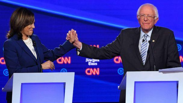 PHOTO: Democratic presidential hopefuls Kamala Harris and Bernie Sanders during the fourth Democratic primary debate at Otterbein University in Westerville, Ohio, Oct. 15, 2019. (Saul Loeb/AFP/Getty Images)