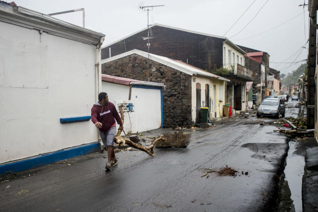 <p>A man clears debris from a street in Saint-Pierre, on the French Caribbean island of Martinique, after it was hit by Hurricane Maria, on Sept. 19, 2017. (Photo: Lionel Chamoiseau/AFP/Getty Images) </p>
